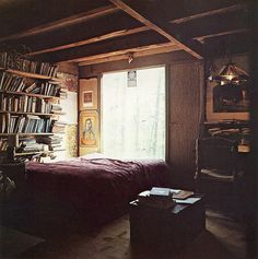 big window by the bed, books and bookshelf, guest room?