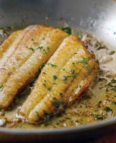 Two fillets of flounder in a lemon butter sauce in a skillet topped with chopped parsley This flounder is made with flounder sautéed in a lemon butter sauce, and finished with fresh herbs. Easy, healthy, quick, and elegant. Baked Flounder, Flounder Recipes, How To Cook Flounder, Grilled Flounder, Fish Dishes, Seafood Dishes, Seafood Recipes, Tater Tots, Lemon Recipes