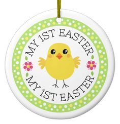 """My first Easter cute chicken custom photo and name Ceramic Ornament. Baby's first Easter ornament featuring a cute cartoon chicken and two pink flowers. Around is a green border with white and yellow, radial polka dots. Text """"My first Easter"""". Customizable photograph, name and year on the back."""