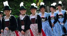 Women wear a dirndl - a traditional dress worn based on the historical costume of Alpine peasants