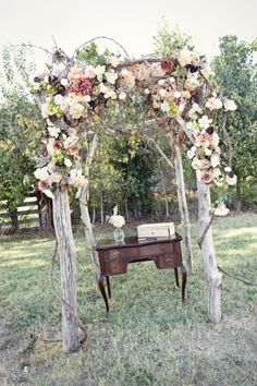 Jaclyn Thomas Design Whitney Rae Photography, Chuppah of tree poles, decorated with blush, taupe, cream flowers