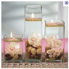 Love the rocks, flower, and candles in water
