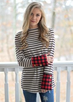 DETAILS: Knit stripe long sleeve blouse Red plaid cuff with buttons Lightweight FABRIC: 96% Poly/4% Spandex Kenlee is wearing a small. Fits true to size.