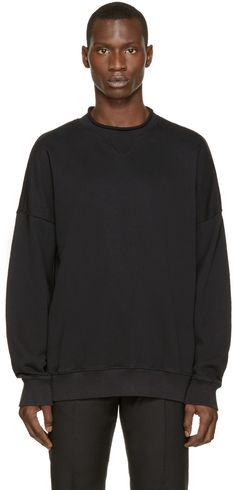 Long-sleeve French terry pullover in soft black. Unfinished crewneck collar. Dropped shoulders. Ribbed cuffs and hem. Tonal stitching.