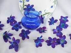 Our NEW Island Orchids are available in 3 colors. This listing is for Blue Island Orchid Heads. These are silk orchid heads. Beautiful royal blue,violet and some have a hint of white. Not all orchids are perfectly the same exact color combination.