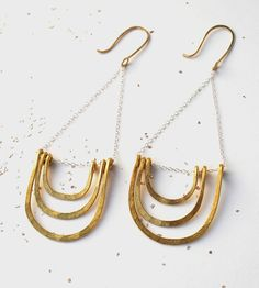 Long, dangly and shiny, these layered arc earrings are designed to catch second (and third and fourth) glances.