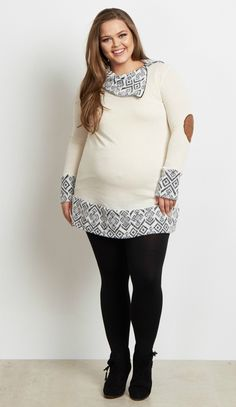 A solid long sleeve maternity top with the perfect tribal accents to make this top stand out among the rest this winter. A stylish zip collar and cuffed sleeves will keep you warm when the weather starts to get cold. Style this maternity plus top with leggings and boots for a complete look.