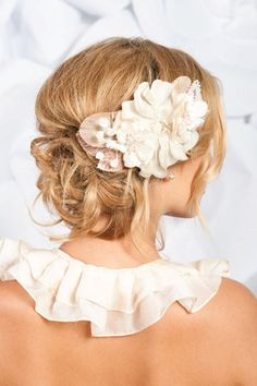 wedding hair updo - low bun - messy - bridal - wedding - boho - flower accessory