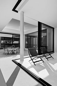 Silver House, on the Greek island of Zante, by Olivier Dwek Architectes. Featuring Emeco Heritage chairs, by Philippe Starck.