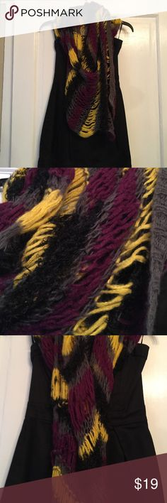 Rachel-Rachel Roy, mixed fabric scarf Rachel-Rachel Roy, woven scarf. Grey, purple, black, yellow, the black being a fuzzy type of fabric all woven in chain like loops to create this awesome looking scarf. I still have the little bag of extra fabric this came with. There are a few loose strands but I can loop them back into place before shipping. RACHEL Rachel Roy Accessories Scarves & Wraps