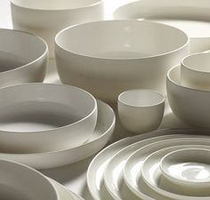 White porcelain plates and bowls designed by Piet Boon for Serax on Oates