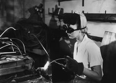 Welding at the K-25 facility in Oak Ridge, in February of 1945. At the height of production, nearly 100,000 workers were employed by the government in the secret city. (Ed Westcott/DOE)