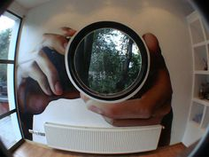 Chilean artist Diego Castillo Roa used a giant wall decal to turn this circular window into a camera lens looking out into the world. It's a submission in Lipton's inspirARTE contest.        Image cre...