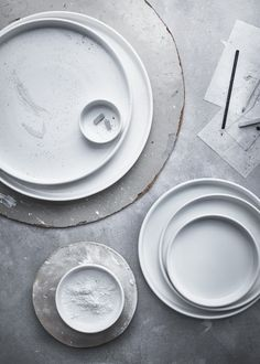 Handmade ceramic plates and bowls in the new, limited edition IKEA collection. Other pieces include handmade glassware, and natural woven furniture and decor! Check it out >>