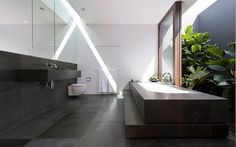 Concrete slabs and white bath, flipped house, MK Architects