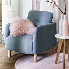 scandinavian grey armchair with pastel pink objects #armchair #scandinaviandesign #pastelpink