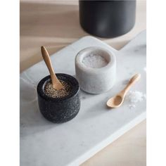 Beautifully smooth with a contrast of colours the Brompton Salt and Pepper Pots are the perfect addition to any dining table.  The deep polished Granite is stores pepper whilst the neutral Marble can house crisp sea salt. The contrast of materials and colours will also ensure there's no confusion over which is which at dinner time.  The pair come complete with two Bamboo spoons to choose the preferred amount of seasoning. The set come in a specially designed Kraft box making a lovely gift.