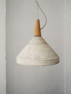Concrete ceiling lamps, by 157+173 designers.