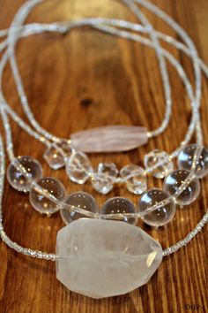 Quartz Necklace by AnndreasArt on Etsy... Rose quartz and crystal quartz - would be so pretty layered