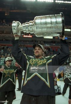 Derian Hatcher of the Dallas Stars celebrates with the Stanley Cup after the Stars defeated the Buffalo Sabres in Game 6 of the 1999 Stanley Cup Finals on June 1999 at the Marine Midland Arena in Buffalo, New York. Blackhawks Hockey, Hockey Teams, Chicago Blackhawks, Hockey Players, Hockey Girls, Hockey Mom, Ice Hockey, Field Hockey, Pittsburgh Penguins Stanley Cup