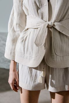 Shorts and belted blazer by Polder