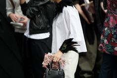 London street style: new take on the fascinator? LOVE the peacock wristlet! - The Cut, NY Times