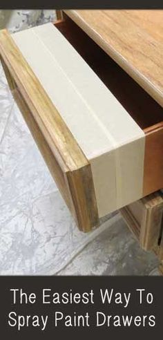 Spray painting drawer fronts can be tricky.  If you pull the drawers out, then you will need to mask the entire drawer, except the drawer front. View the slideshow below to read more: