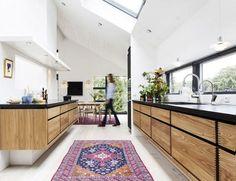 Modern kitchen with kilim rugs.