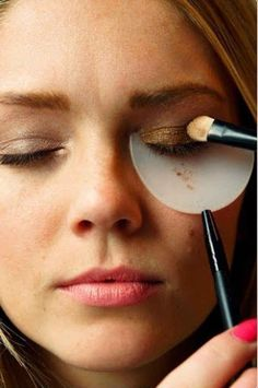 Or, pick up a shadow and mascara shield to hold under your eye as you apply.