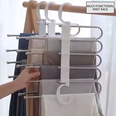 The adjustable storage rack can be hung steadily with two hooks or it can be hung vertically, it can hold up to 5 pairs of pants at one time and it will make your closet tidier. Organiser Son Dressing, Hanging Pants, Pants Rack, Diy Home Decor, Room Decor, Pant Hangers, Hanger Hooks, Storage Rack, Storage Ideas
