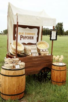 Feeling whimsical on your wedding day? How about providing a popcorn bar
