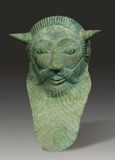 Rare applique représentant le dieu-fleuve Achéloos.  Étrurie, probablement Tarquinia, ca. 500 av. J.-C. H_16 cm