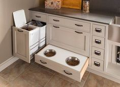 The Kessebohmer waste bin pullout unit was featured in Apartment Therapy's article 10 Clever Hidden Storage Solutions You'll Wish You Had at Home. Thanks Wood Mode for the great photo. Animal Room, Dog Food Storage, Hidden Storage, Storage Ideas, Diy Storage, Cabinet Storage, Wood Storage, Secret Storage, Storage Bins