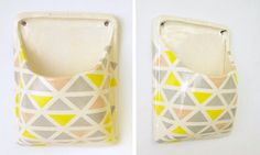 Ceramic wall pouch. This could be a handy phone holder beside the bed.