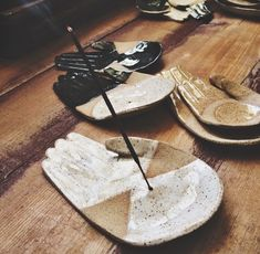 """These different take on the smaller Open Palm plates come with a hole in the palm of the hand to place your incense, and enough space to catch the ashes as they fall. They measure around 5"""""""