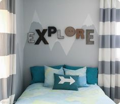 Little explorer bedroom with painted mountains and painted duvet cover