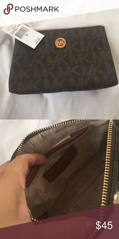 Brown Michael Kors cosmetic bag Brown PVC Michael Kors cosmetic bag. Never used. No scratches or stains. Michael Kors Bags Cosmetic Bags & Cases
