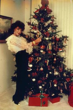THE JOAN COLLINS ARCHIVE: December 2011