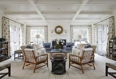 Love the beams and board ceiling. Plus all the natural light. The wicker chairs aren't so bad either