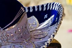 Sombrero, a traditional Mexican hat is described as one with a wide brim that is commonly worn by workers, middle and upper-class people, and during celebrations. It's made to efficiently protect the wearer from the harmful rays of the sun. I'd love to help you plan your trip, so call me! #yucatan #merida #mexicanpeninsula #visityucatan #visitmerida #travelmerida #travelmexicanpeninsula #traveldestination #travelplanning #sombrero #mexicanhat #funfacts #facts #sombrerofunfacts Mexican Army, Mexican Hat, Cancun, Mexican Wedding Reception, Karaoke, Festivals, Ok Kid, Moving Across Country, Learn Spanish Online
