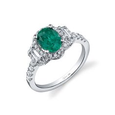 Brides.com: 71 Engagement Rings with Colorful Stones. Style SY596S EM, 1.96TW engagement ring W. 8X6 oval emerald head 18KW, $7,660, Sylvie Collection                                                                                                               See more Sylvie Collection engagement rings.