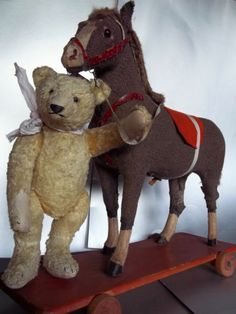 Sweet teddy and his horse  The two go together - bears and a horse for them to sit on~!