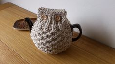 Oatmeal hand knitted tea cosy with wooden button- Looks sort of like an owl