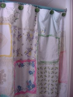 This would be a great shower curtain for my guest bath with the old pink tub. It is made out of hankies! Don't think I quite have enough...