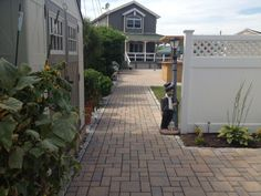 This stunning pavingstone walkway was created using Cambridge Pavingstones with Armortec. Add a pavingstone walkway to your backyard today!