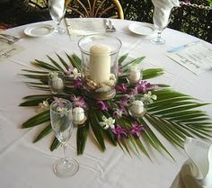 Palm with shell candles scattered on top, earth tones.