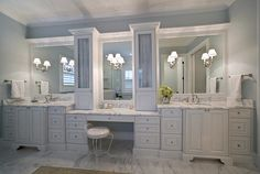 photo Bathroomstudiominteriordesign001.jpg Love the storage columns to break up a long vanity and mirror.