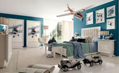 room-decorating-ideas-planning-themes-space-nursery-decor-makeover-rooms-red-white-and-teal-aeronautical-themed-boys-room-with-helicopter-replica-above-the-bed-826x507.jpeg (826×507)