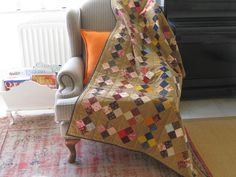 Four Patch quilt by http://quiltingstories.blogspot.com/2013/11/four-patch-machine-pieced-hand-quilted.html