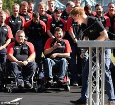 People's Prince: A good-natured Harry retrieves his speech as the British Invictus team watches, laughing